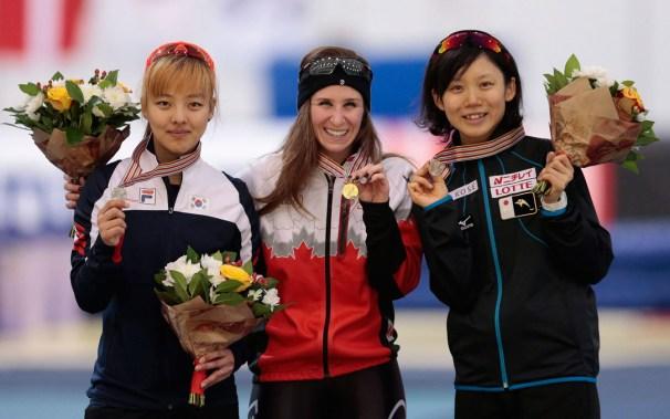 Blondin with her medal alongside other medallists