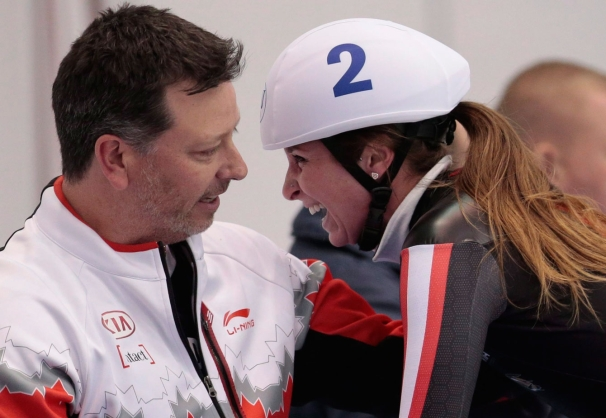 Blondin and her coach react after she won