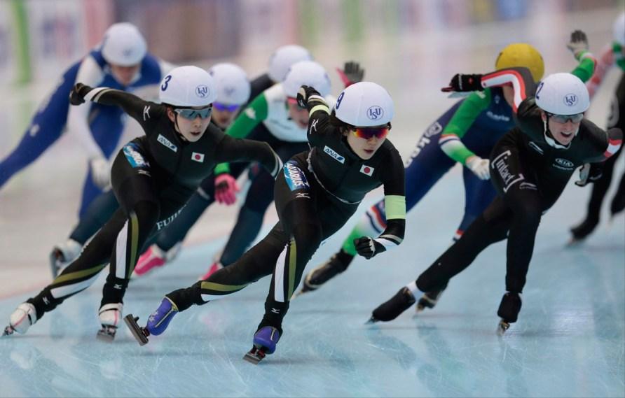 From left, Oshigiri Misaki, Takagi Miho, both of Japan, and Ivanie Blondin, of Canada, lead the pack on the last lap of the women's mass start race of the speedskating single distance World Championship