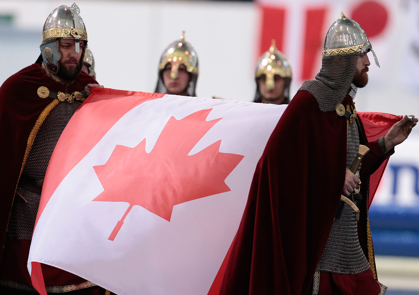 Performers, dressed as ancient Russian warriors, carry Canadian flag for the victory ceremony of the women's mass start race of the speed skating single distance World Championships in Kolomna, Russia, on February 14, 2016. (AP Photo/Ivan Sekretarev)