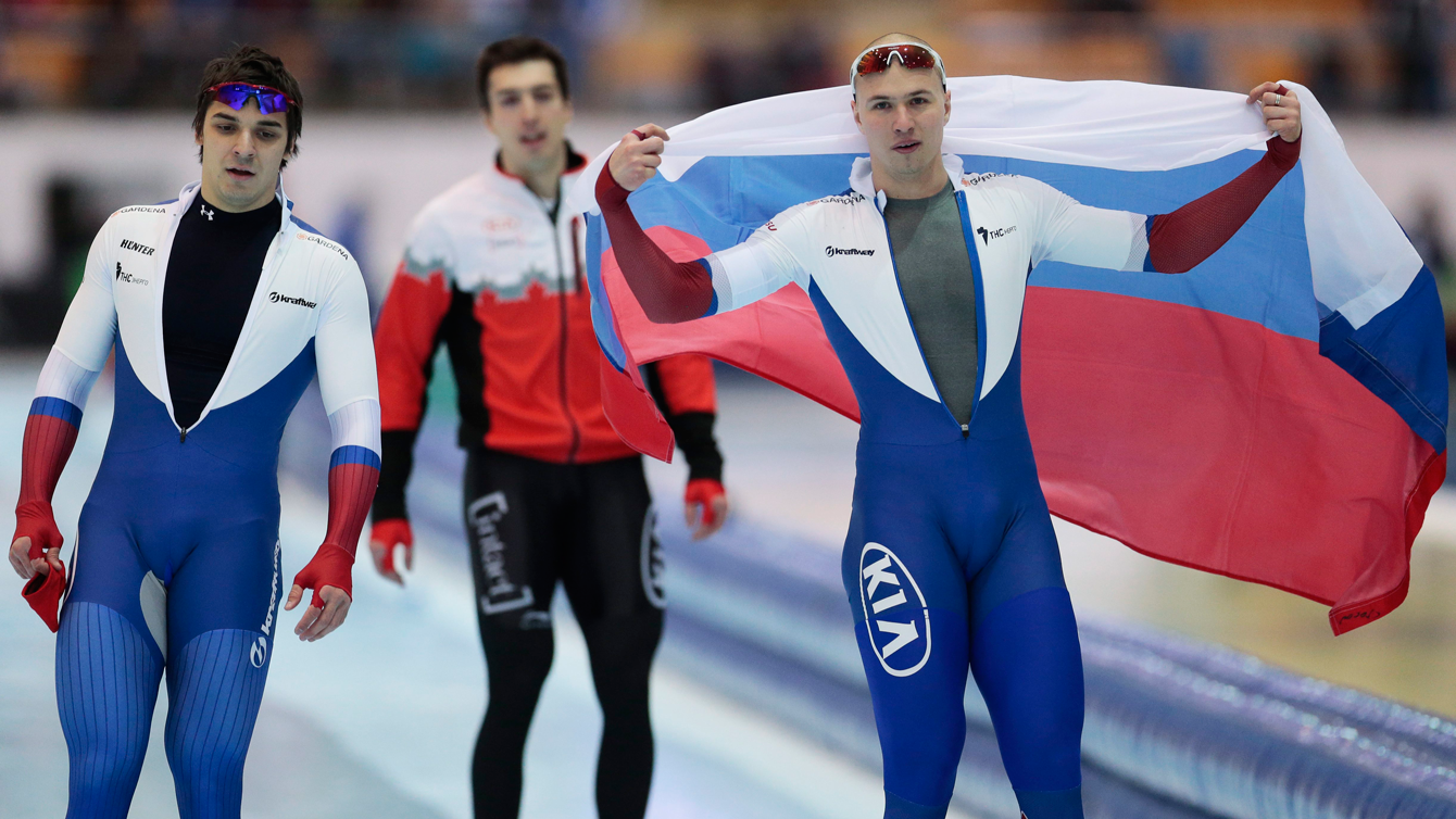 Canada's Alex Boisvert-Lacroix (centre), flanked by Russia's Pavel Kulizhnikov (right) and Ruslan Murashov, after second heat of the men's 500m race of the speed skating single distance world championships in Kolomna, Russia, on February 14, 2016.