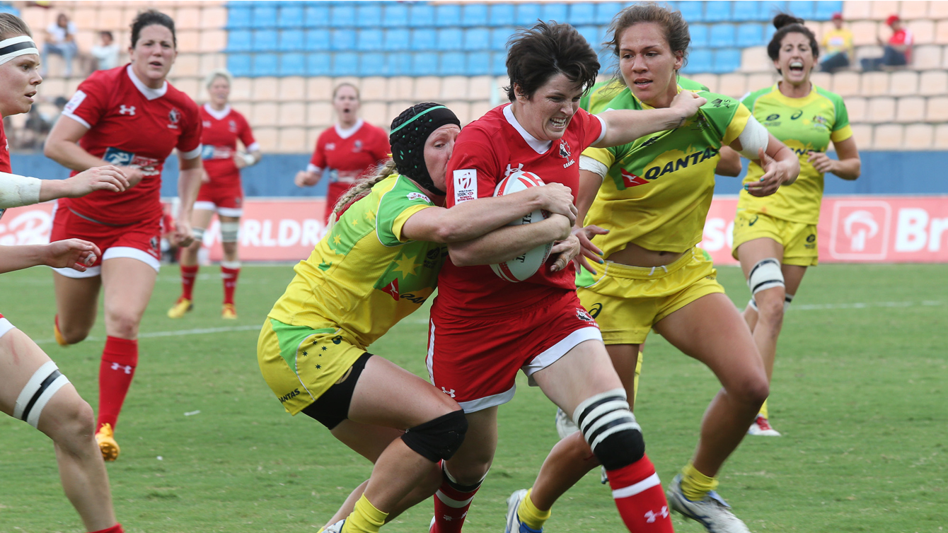 Britt Benn being tackled by Australian players during pool match in Sao Paulo on February 20, 2016.