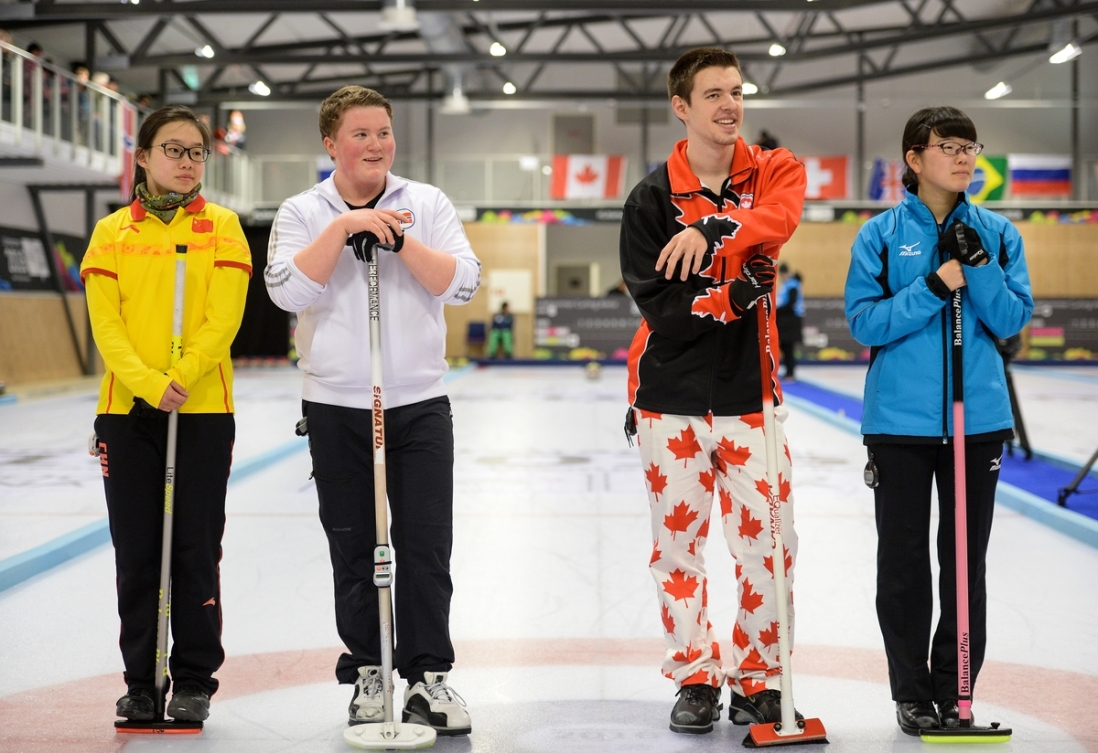 Ruiyi Zhao CHN, Andreas Haarstad NOR, Tyler Tardi CAN and Honoka Sasaki JPN (left to right) seen before the Mixed Doubles Finals Bronze Medal Game at Lillehammer Curling Hall during the Winter Youth Olympic Games, Lillehammer, Norway, 21 February 2016. Photo: Jon Buckle for YIS/IOC Handout image supplied by YIS/IOC