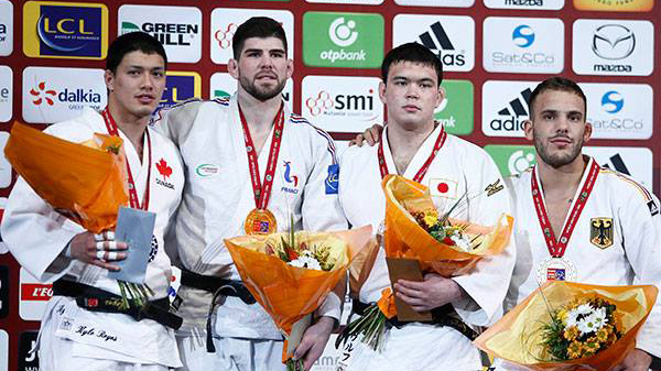 Kyle Reyes, left celebrates after finishing second in the men's 100kg at the Paris Grand Slam on February 7, 2016. Photo: International Judo Federation