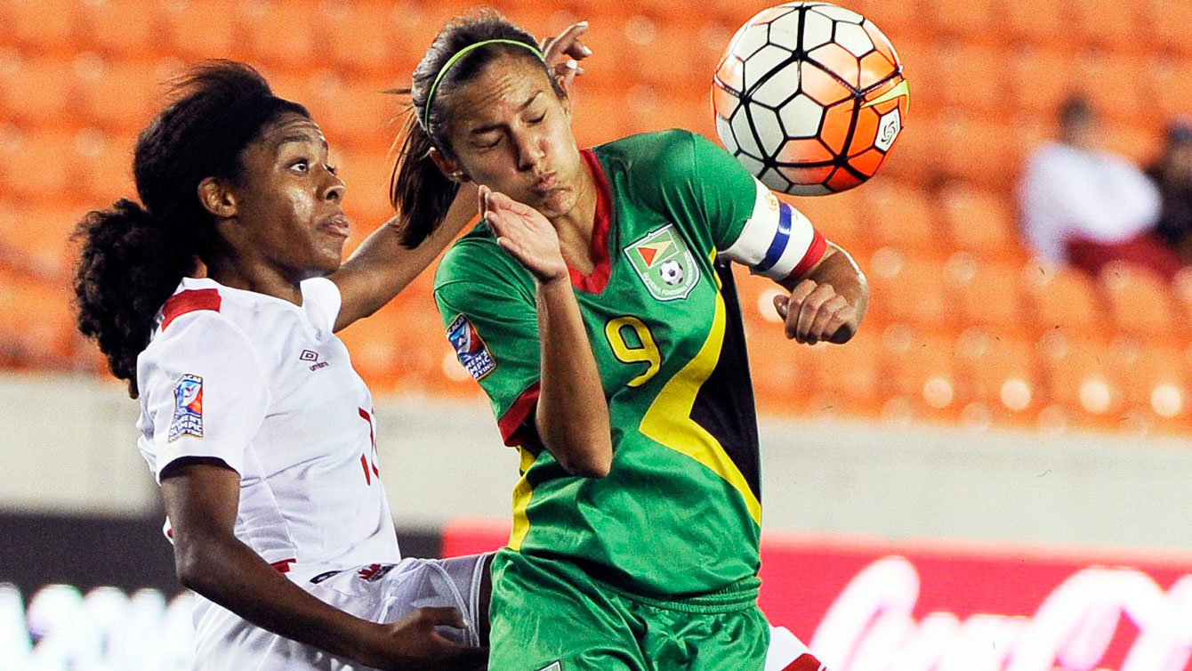 Ashley Lawrence (left) goes for a ball against Ashley Rodrigues of Guyana on February 11, 2016.