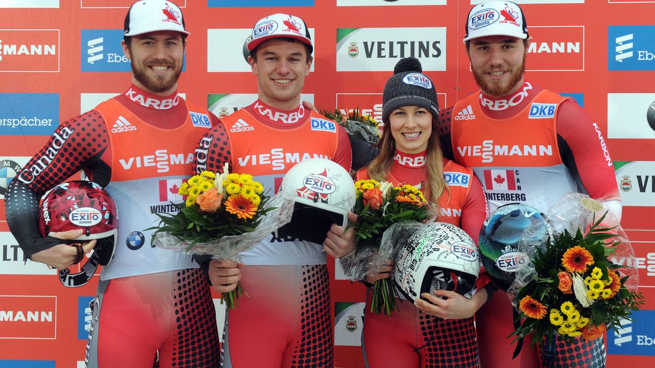 Canadians on the podium in first place at the Luge World Cup relay in Winterberg on February 21, 2016.