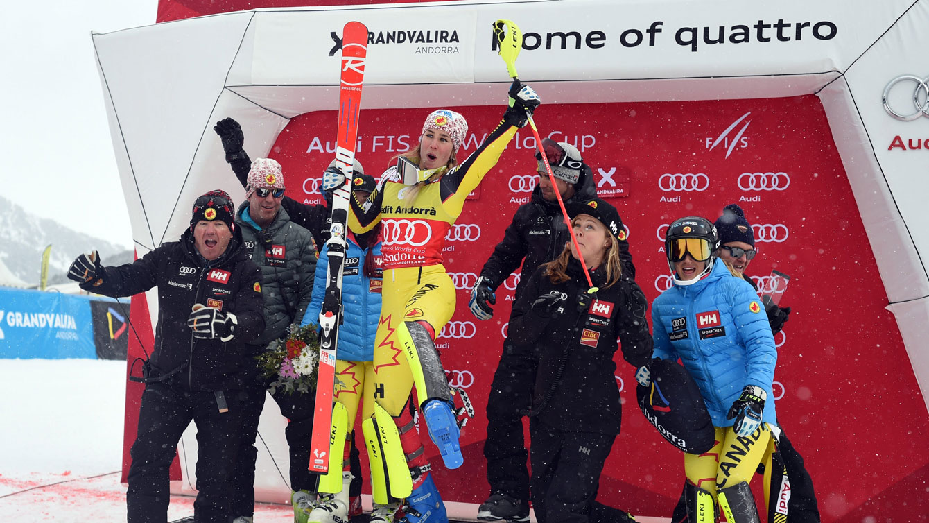 Marie-Michele Gagnon (in yellow) celebrates after winning the women's alpine combined in Andorra on February 28, 2016.