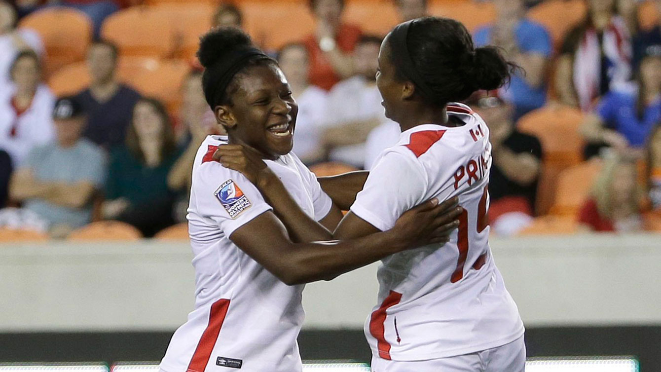 Deanne Rose (left) and Nichelle Prince celebrate Rose's goal in the Olympic qualifying tournament against Costa Rica on February 19, 2016.
