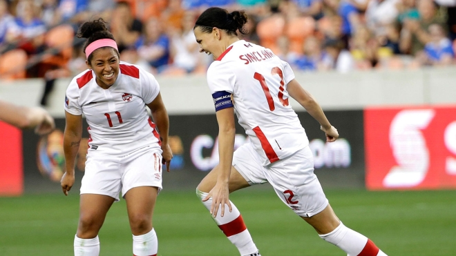 Christine Sinclair (right) celebrates her second goal against Costa Rica in Olympic qualifying with Desiree Scott looking on - February 19, 2016.