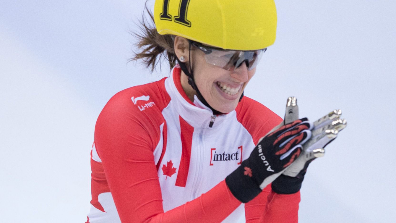 Marianne St-Gelais reacts after crossing the finish line as she won the women's 500 m final at the ISU Short track World Cup event in Dresden, Germany, Sunday Feb. 7, 2016.