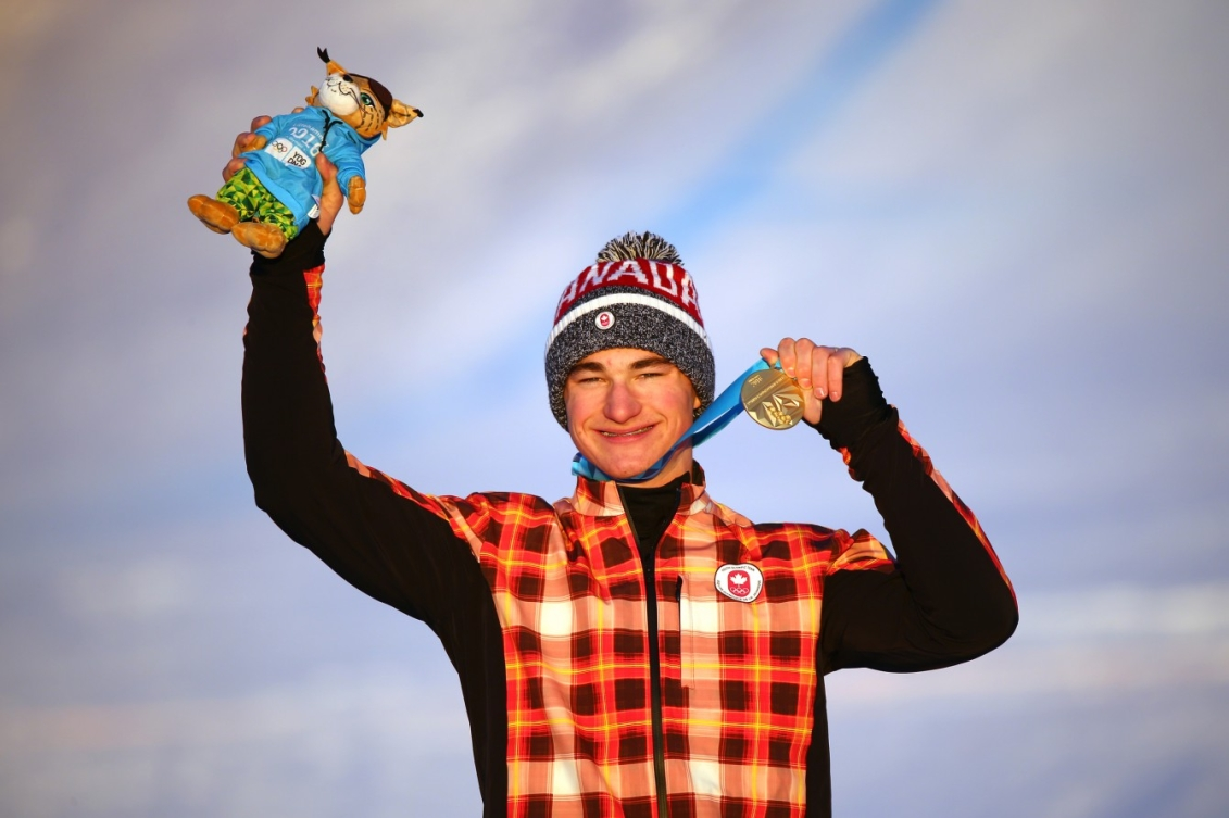 Gold medallist Reece Howden CAN poses on the podium after the Men's Ski Cross at the Hafjell Freepark during the Winter Youth Olympic Games, Lillehammer Norway, 15 February 2016. Photo: Simon Bruty for YIS/IOC Handout image supplied by YIS/IOC