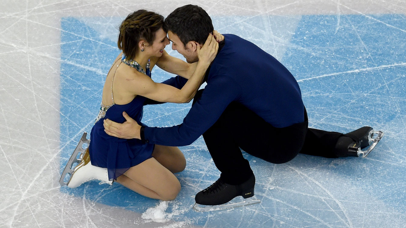 Meagan Duhamel and Eric Radford enjoy and emotional celebration at the conclusion of their free program at the ISU Figure Skating World Championships in Boston on April 2, 2016.