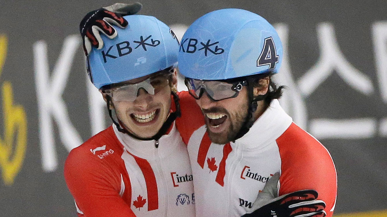 Charles Hamelin (right) and Samuel Girard celebrate going 1-2 at the World Short Track Speed Skating Championships in the 1000m on March 13, 2016 in Seoul, South Korea.