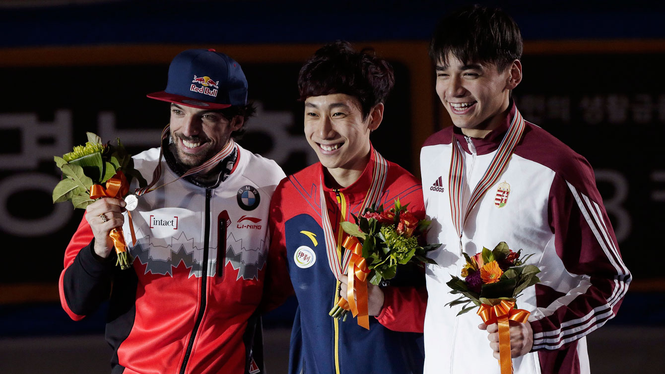 Charles Hamelin (left in silver position) during the presentation of the overall points awards at the 2016 ISU World Short Track Speed Skating Championships in Seoul, South Korea on March 13, 2016.