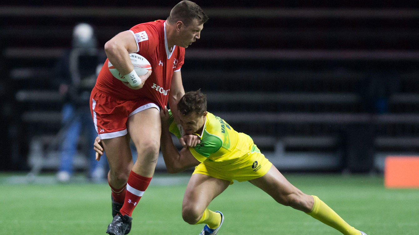 Adam Zaruba gets away from Australia's Stephan van der Walt during World Rugby Sevens Series' Canada Sevens tournament debut in Vancouver on March 12, 2016.