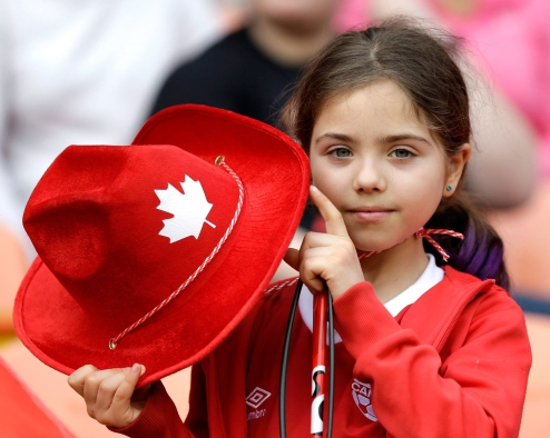 A young fan shows her support for Canada as the women's soccer team takes the field for a CONCACAF Olympic qualifying tournament soccer match. (AP Photo/David J. Phillip)