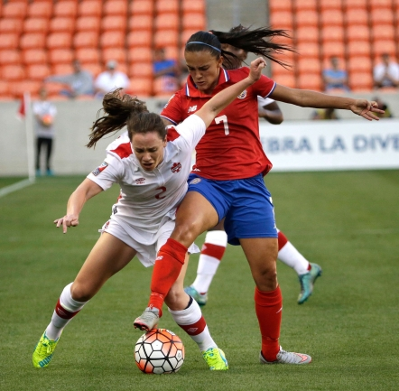 Canada's Allysha Chapman (2) challenges Costa Rica's Melissa Herrera (7) for the ball during the first half of a CONCACAF Olympic women's soccer qualifying championship semifinal Friday, Feb. 19, 2016, in Houston. (AP Photo/David J. Phillip)