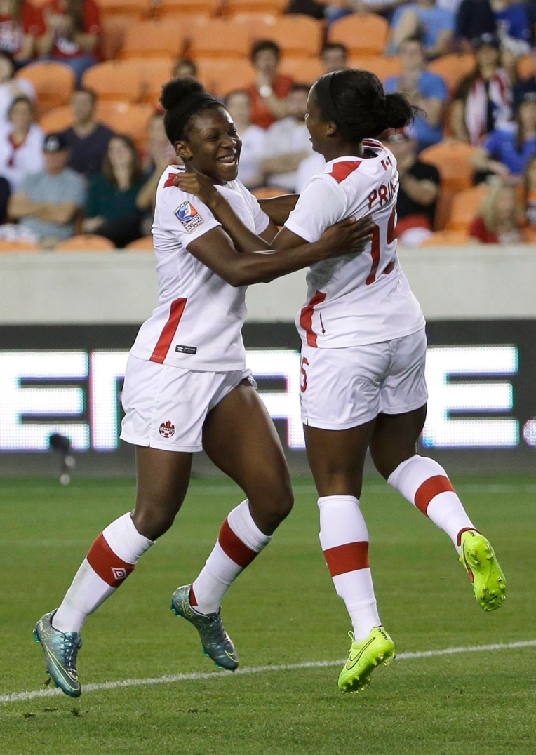 Canada's Deanne Rose, left, celebrates after scoring a goal with Nichelle Prince during the second half of a CONCACAF Olympic women's soccer qualifying championship semifinal against Costa Rica, Friday, Feb. 19, 2016, in Houston. Canada won 3-1. (AP Photo/David J. Phillip)
