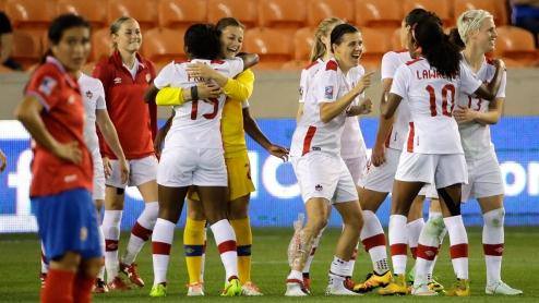 Canada players celebrate after beating Costa Rica in a CONCACAF Olympic women's soccer qualifying championship semifinal Friday, Feb. 19, 2016, in Houston. Canada won 3-1. (AP Photo/David J. Phillip)