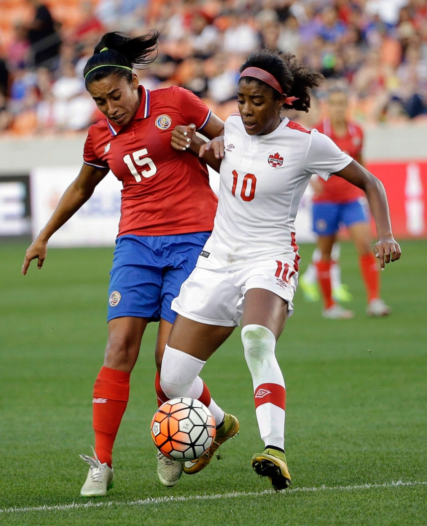 Canada's Ashley Lawrence (10) challenges Costa Rica's Cristin Granados (15) for the ball during the second half of a CONCACAF Olympic women's soccer qualifying championship semifinal Friday, Feb. 19, 2016, in Houston. Canada won 3-1. (AP Photo/David J. Phillip)