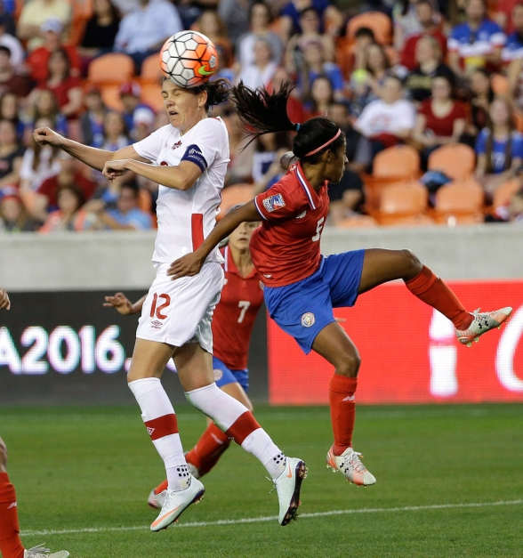 Canada's Christine Sinclair (12) heads the ball as Costa RicaÔø?s Diana Saenz (5) defends during the second half of a CONCACAF Olympic women's soccer qualifying championship semifinal Friday, Feb. 19, 2016, in Houston. Canada won 3-1. (AP Photo/David J. Phillip)