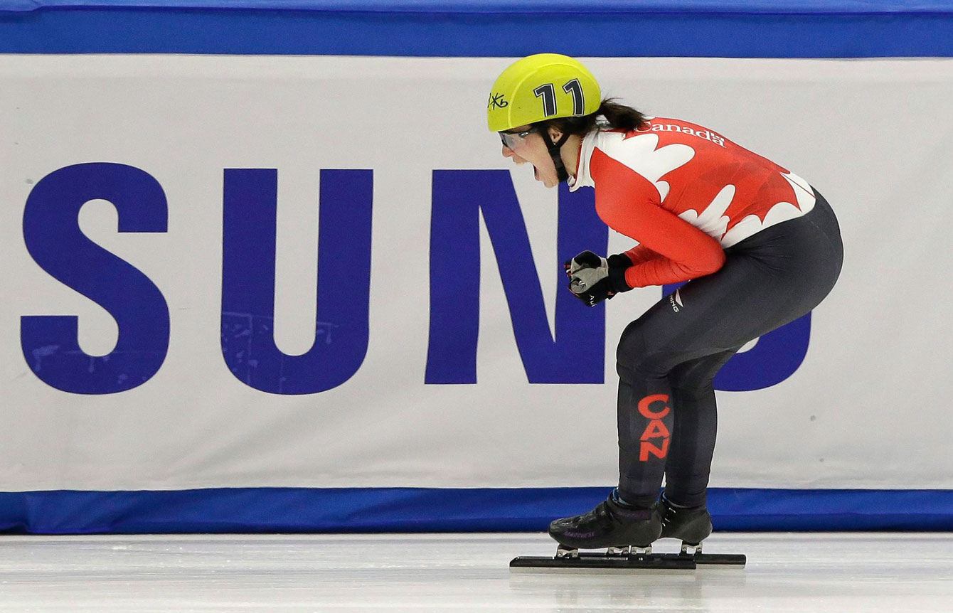 Marianne St-Gelais of Canada celebrates after wining the women's 1500 metre final at the ISU World Short Track Speed Skating Championships in Seoul, South Korea, Saturday, March 12, 2016. (AP Photo/Ahn Young-joon)