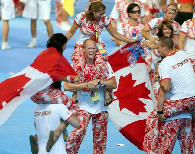 Canadian athletes celebrate during closing ceremony