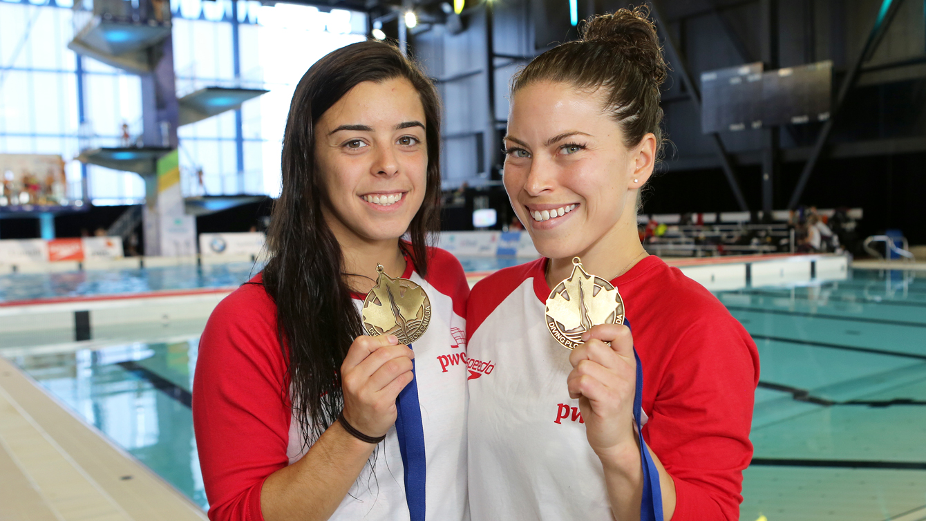 Meaghan Benfeito and Roseline Filion after winning the women's 10 synchro competition at the FINA Diving Grand Prix in Gatineau on April 9. (Greg Kolz)