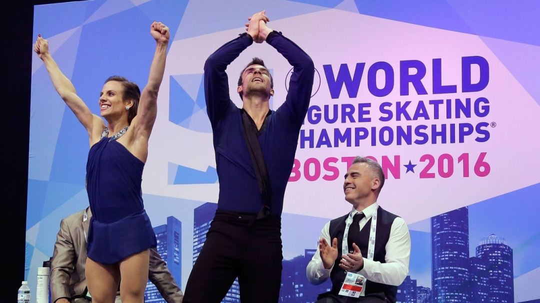 Meagan Duhamel and Eric Radford celebrate in the kiss and cry