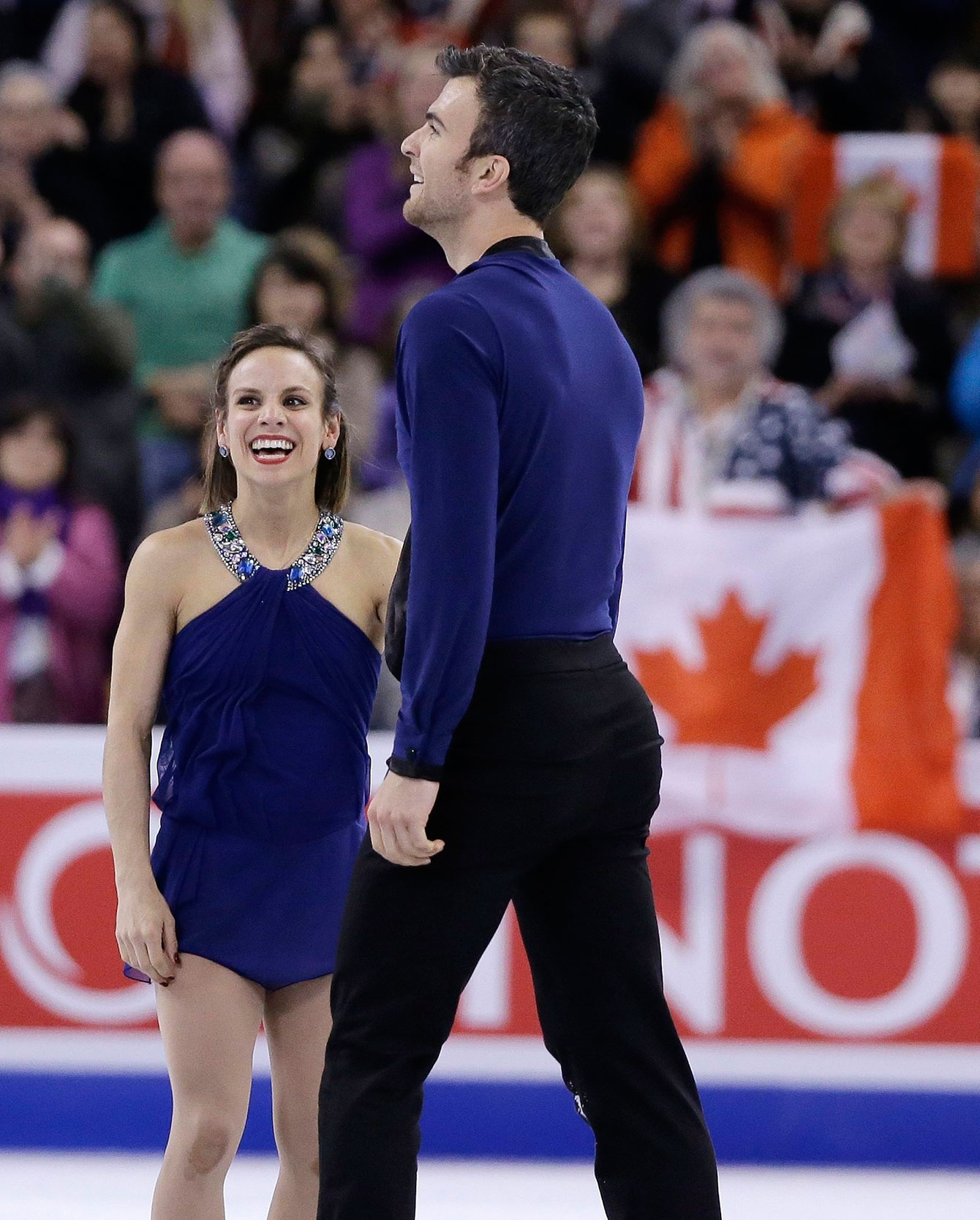 Meagan Duhamel and Eric Radford show relief after a monstrous performance in the free skate at the ISU Speed Skating World Championships on April 2, 2016.