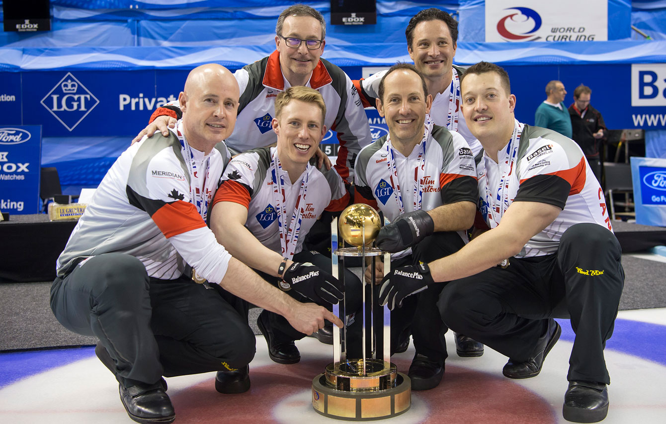 (Front L-R) Kevin Koe, Marc Kennedy, Brent Laing, Ben Hebert. (Back L-R) Coach John Dunn and alternate Scott Pfeifer with the world championship trophy on April 10, 2016.