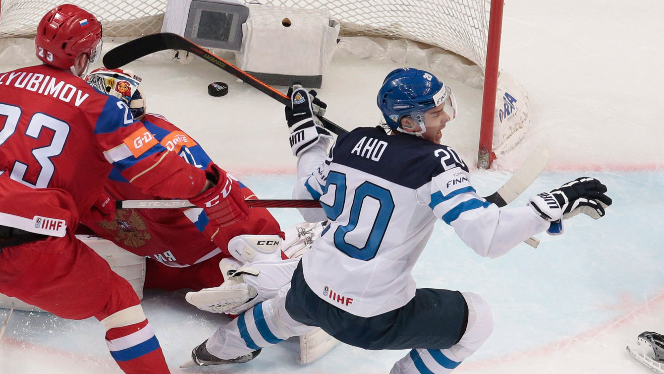 Finland's Sebastian Aho (right) celebrates his goal against Russia at IIHF worlds semifinal on May 21, 2016.
