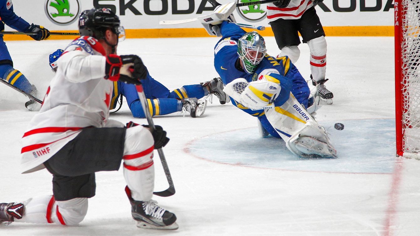 Canada's Max Domi, left, scores a goal to Sweden's goalie Jacob Markstrom during the Hockey World Championships quarterfinal match between Canada and Sweden in St.Petersburg, Russia, Thursday, May 19, 2016. (AP Photo/Dmitri Lovetsky)