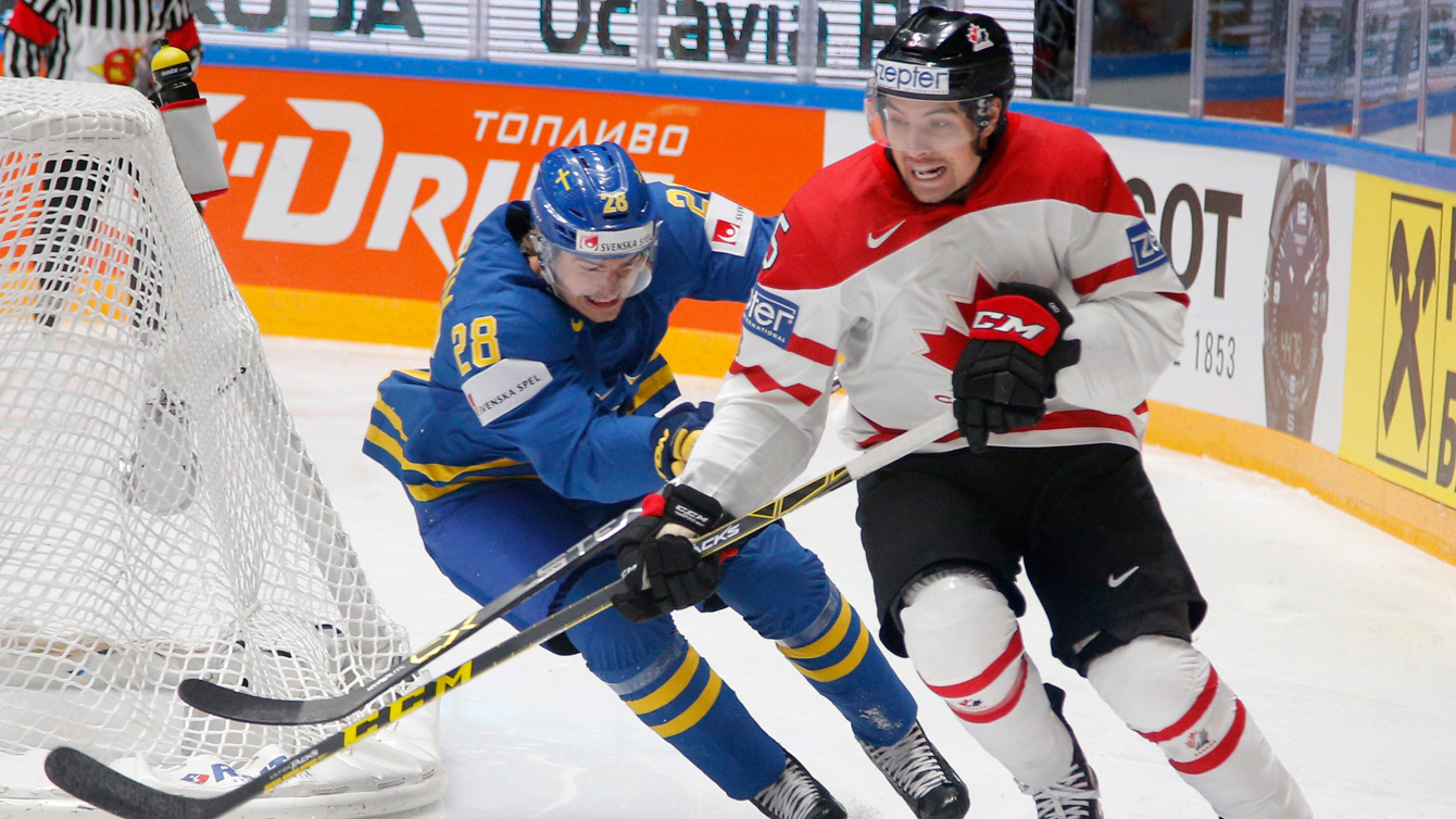 Canada's Cody Ceci, right, fights for the puck with Sweden's Johan Sundstrom during the Hockey World Championships quarterfinal match between Canada and Sweden in St.Petersburg, Russia, Thursday, May 19, 2016. (AP Photo/Dmitri Lovetsky)