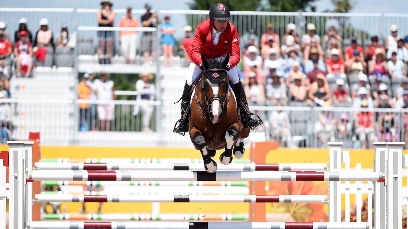Eric Lamaze of Canada competes in the team Equestrian jumping final during the Pan American Games in Caledon, Ont. on July 23, 2015. THE CANADIAN PRESS/Nathan Denette