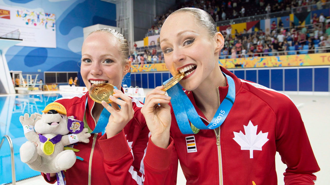 Jacqueline Simoneau and Karine Thomas at Toronto 2015 Pan American Games after winning their duet gold medal.
