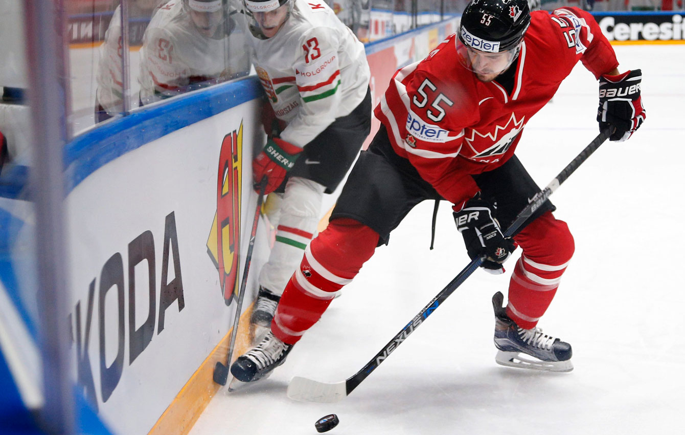 Mark Scheifele fights for the puck at the Hockey World Championships in St. Petersburg, Russia on May 8, 2016. (AP Photo/Dmitri Lovetsky)