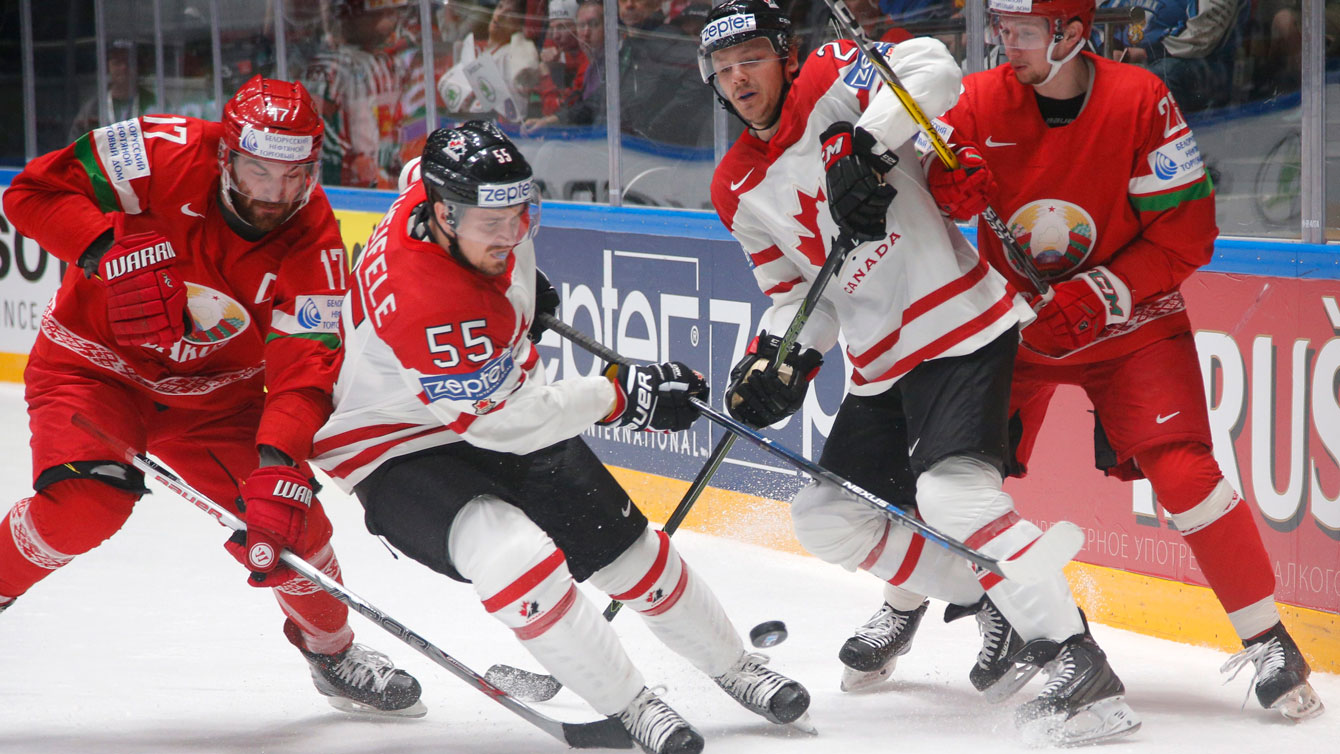 Mark Scheifele and Sam Reinhart fight for the puck at the Hockey World Championships in St.Petersburg, Russia, on May 9, 2016. (AP Photo/Dmitri Lovetsky)