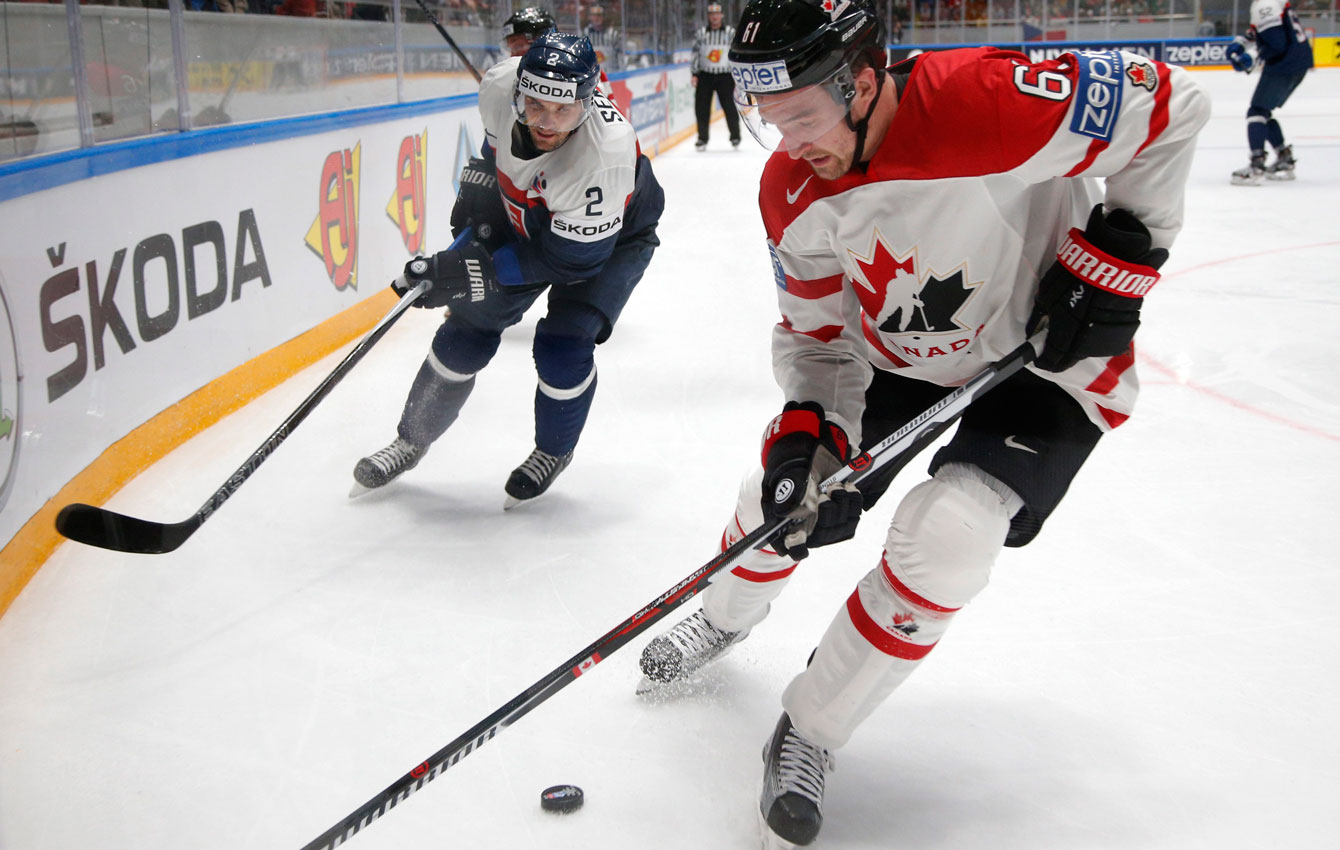 Mark Stone fights for the puck during the Hockey World Championships in St.Petersburg, Russia, on May 14, 2016. (AP Photo/Dmitri Lovetsky)