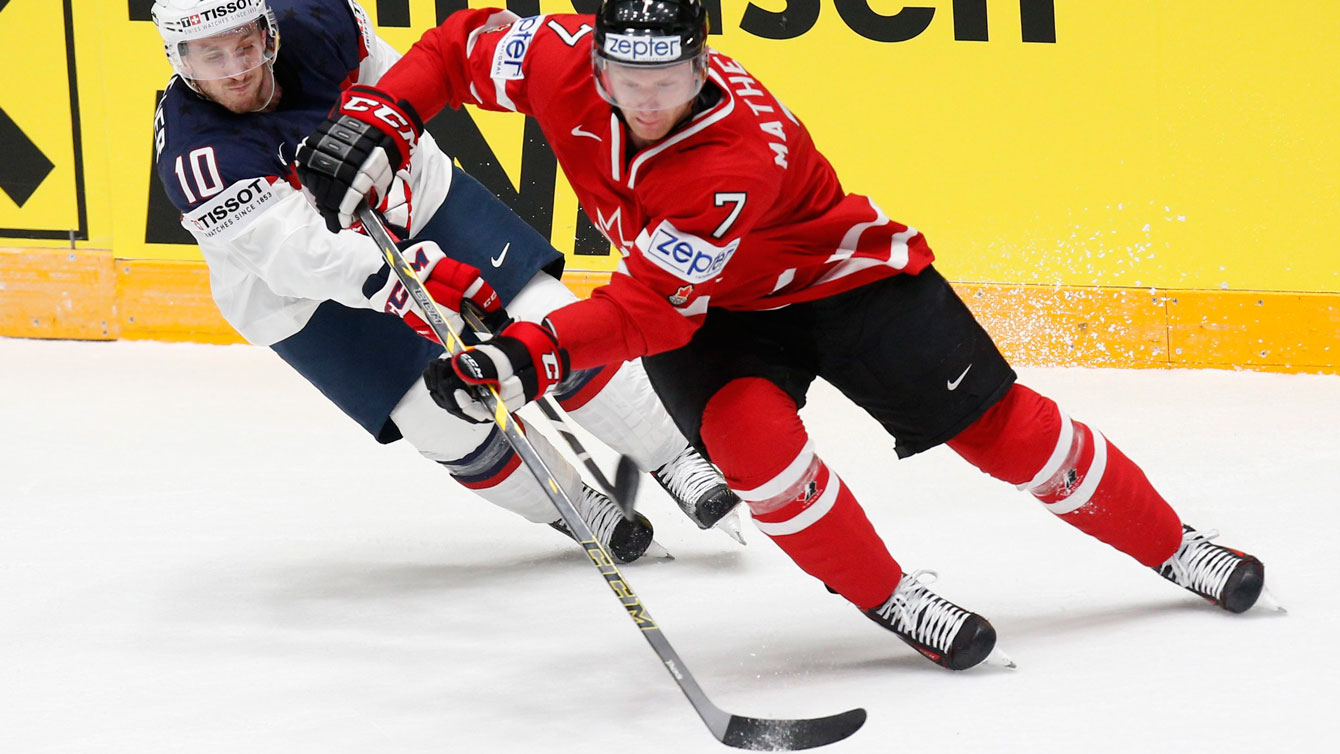 Michael Matheson holds off Jordan Schroeder of the United States at the IIHF World Championships in St.Petersburg, Russia on May 6, 2016. (AP Photo/Dmitri Lovetsky)
