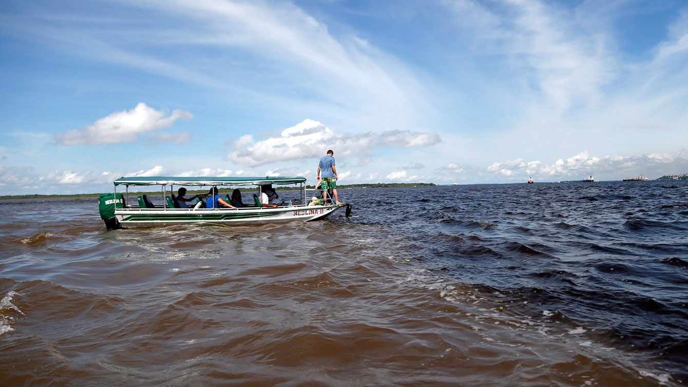 Meeting of waters, the confluence between Rio Negro and Amazon River