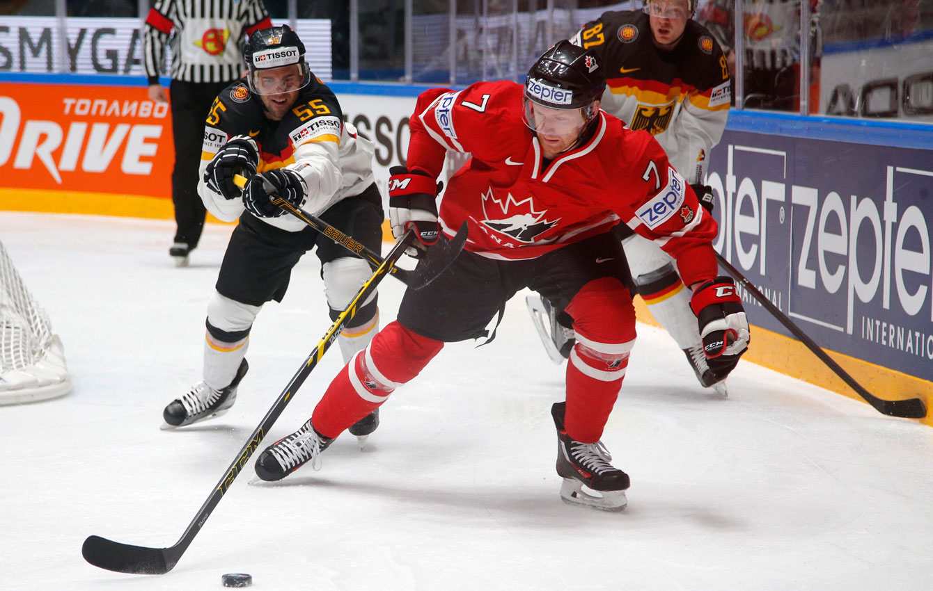 Michael Matheson, out skates Germany's Felix Schutz at the Hockey World Championships St.Petersburg, Russia, on May 12, 2016. (AP Photo/Dmitri Lovetsky)