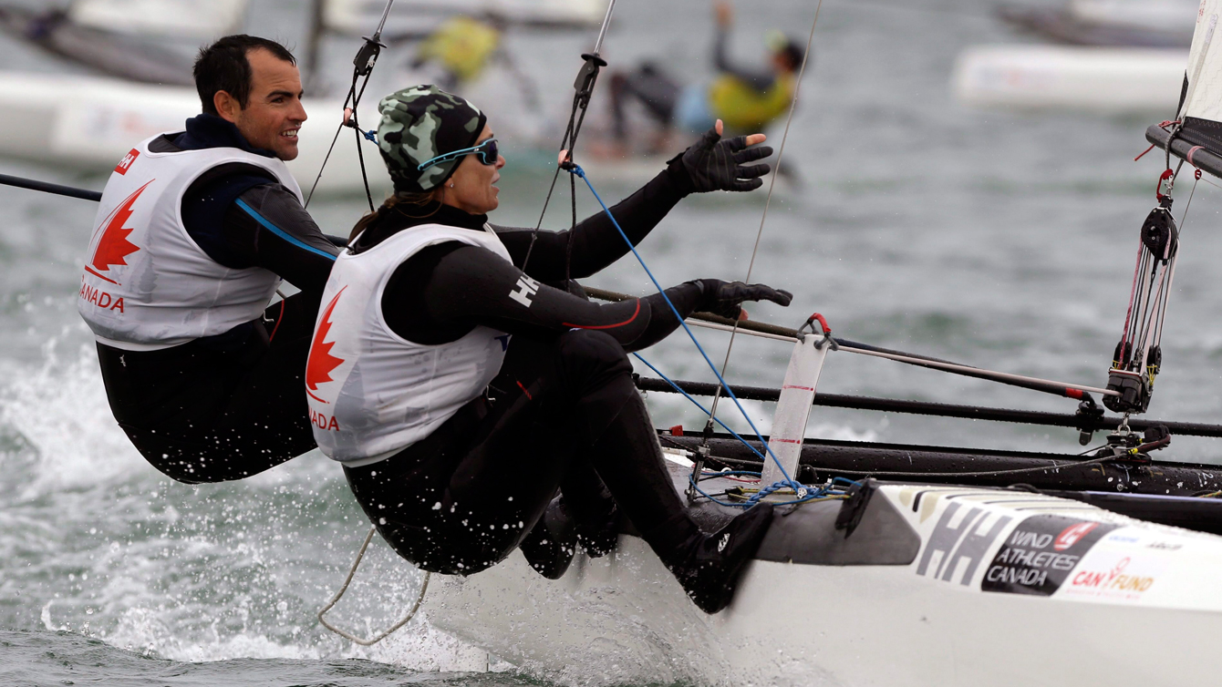 Canada's sailing team of Luke Ramsay, left, and Nikola Girke, right, compete in the Nacra 17 class during the ISAF Sailing World Cup Miami on Jan. 29, 2016. (AP Photo/Lynne Sladky)
