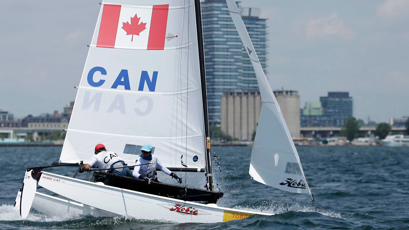 Canada's boat gets the bows underwater in the Hobie 16 medals race during sailing competition in the Pan Am Games in Toronto on July 19, 2015. (AP Photo/Gregory Bull)