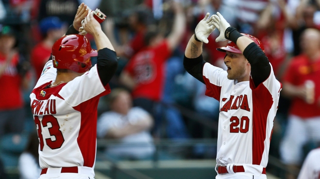 Justin Morneau and Michael Saunders celebrate a home run