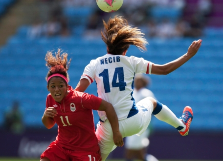 Canada's Desiree Scott, left, fights for the ball against Canada's Desiree Scott during their bronze medal women's soccer match at the 2012 London Summer Olympics, Thursday, Aug. 9, 2012 at the Ricoh Arena Stadium in Coventry, England. (AP Photo/Jon Super)