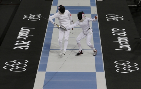 Canada's Donna Vakalis, right, competes against China's Chen Qian, left, during the fencing portion of the women's modern pentathlon competition at the 2012 Summer Olympics Sunday, Aug. 12, 2012, in London. (AP Photo/Hussein Malla)