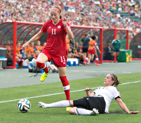 Canada's Janine Beckie (11) and Germany's Wibke Meister (15) battle for the ball during second half action of the FIFA U-20 Women's World Cup quarter-finals in Edmonton, Alta., on Saturday August 16, 2014. THE CANADIAN PRESS/Jason Franson