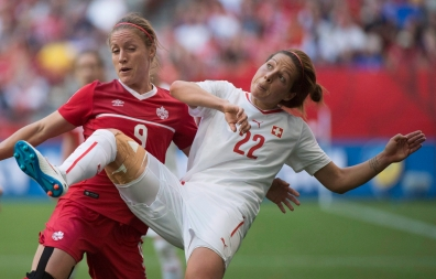 Switzerland's Vanessa Bernauer, right, fights for control of the ball with Canada's Josee Belanger during the second half of FIFA Women's World Cup round of 16 soccer action in Vancouver, B.C. Sunday, June 21, 2015. THE CANADIAN PRESS/Jonathan Hayward