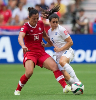 Canada's Melissa Tancredi, left, and England's Claire Rafferty vie for the ball during first half FIFA Women's World Cup quarter-final soccer action in Vancouver, B.C., on Saturday June 27, 2015. THE CANADIAN PRESS/Darryl Dyck